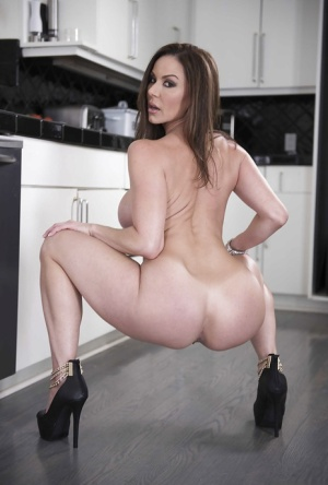 Hot wife Kendra Lust exposing large MILF tits in kitchen during babe spread 18290097