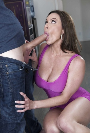 Busty wife Kendra Lust freeing big MILF tits from dress before giving BJ 28153771