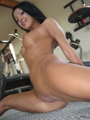 Sports babe Maya Gates spreading her shaved cunt in the gym