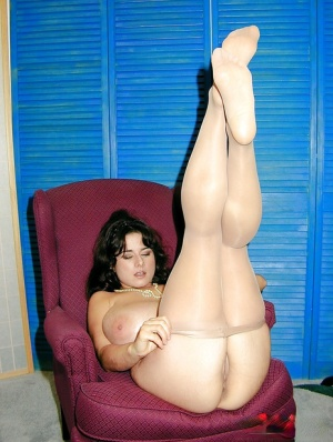 Buxom French model Chloe Vevrier pulling pantyhose up legs and over beaver