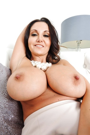 European MILF pornstar Ava Addams unveiling huge boobs and hairy muff