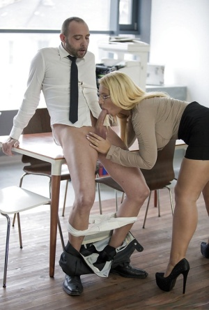 Sexy blonde Kyra Hot giving oral sex in black skirt and glasses to coworker