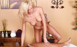 Blonde masseuse Victoria White jerking and sucking off client in heels