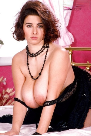 Eccentric brunette Chloe strips off to pose naked and to boast of her big tits