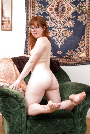 Amateur redhead Carrie B takes down the undies to reveal her hairy snatch 61278160