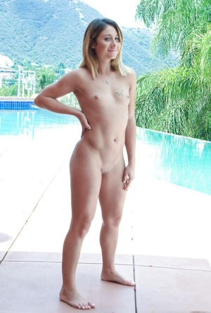 Blonde solo girl Chloe Lane modeling naked on patio after undressing indoors