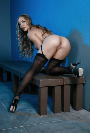 Blonde pornstar Nicole Aniston showing off phat ass in stockings and heels 97084134