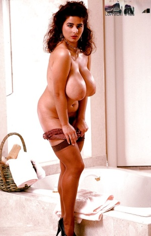 Busty European vixen with hairy pussy soaps her big boobs and bubble ass
