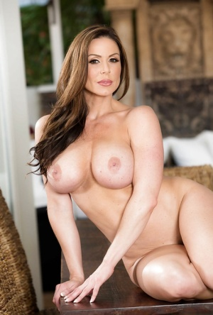 MILF Kendra Lust exposing nice melons after shucking apron and underthings