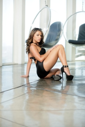 Solo model Adriana Chechik peels off black lingerie in sexy manner