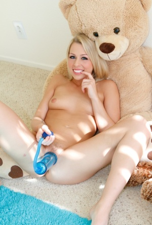 Cute blonde Zoey Monroe is all smiles while pleasing her own pussy