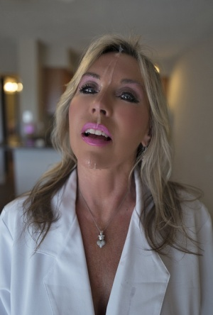 Middle aged housewife Sandra Otterson jerks off hubbys cock for facial jizz