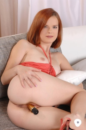 Sexy redhead Denisa inserts a sex toy into her all natural pussy
