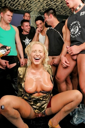 Filthy blonde slut having her face and tits covered in jism and piss