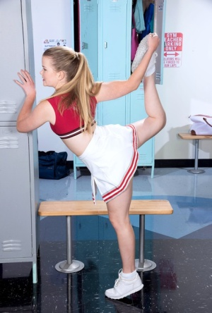 Barely legal cheerleader Lexy takes off white cotton panties in locker room