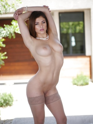 Teen girl Leah Gotti taking off her clothes to model naked on sidewalk