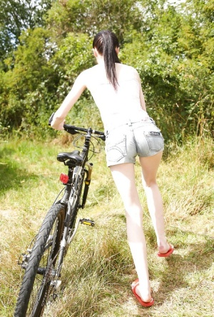Barely legal teen Mia Evans dismounting bike for masturbation in the woods