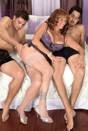 Hot mature broad Sheri Fox showing a couple of younger guys a good time