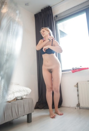 Blonde amateur with hairy pussy Alina L dressing in skirt on hidden cam