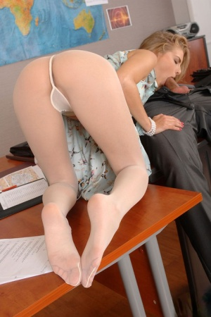 Kinky MILF Cayenne Klein in white pantyhose gives a foot job gets toes licked