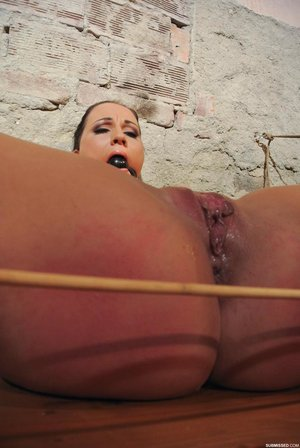 Clair Brooks lays chained to a wall with her legs open for forced machine sex