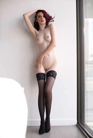 Solo girl Nico Faye strips off lingerie to model in stockings only