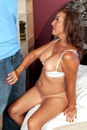 Over 50 woman Trisha greets her gigolo for the evening in just a white bra 13962243