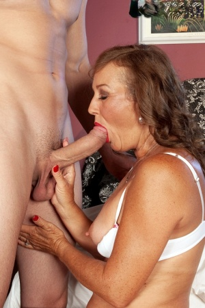 Over 50 woman Trisha greets her gigolo for the evening in just a white bra