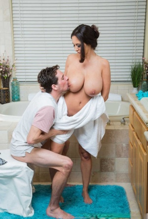 Charming busty sweetheart Ava Addams licks cock and enjoys it between her jugs