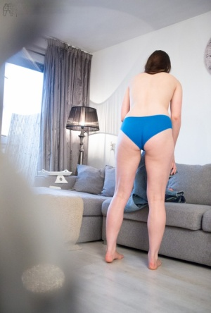Naked amateur female pulls on her panties and then her blue jeans