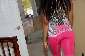 Long-haired ebony vixen Mya Lushes takes off pink pants showing a topnotch ass