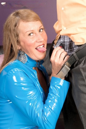 Older lady Trisha sucks off a big dick wearing latex and stockings