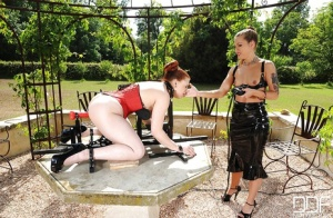 European bitches fuck each other with a big strapon outdoors in a BDSM manner