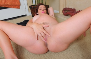 Middle-aged pregger Alicia Silver goes about masturbating her horny snatch