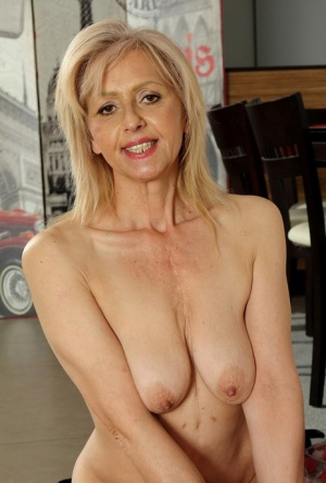 Older blonde broad uncovers her saggy tits as she removes her black dress