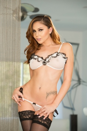 Hot solo model Ariana Marie doffs lingerie ensemble to pose in nylons only