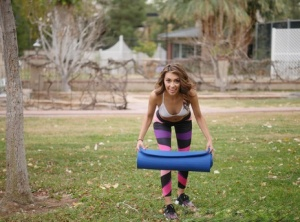 Yoga enthusiast Kara Faux removes her clothes on her yoga mat out on the lawn