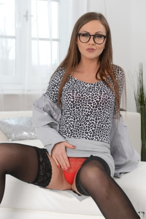 Solo girl Tina Kay removes her glasses before stripping down to black nylonss 83450112