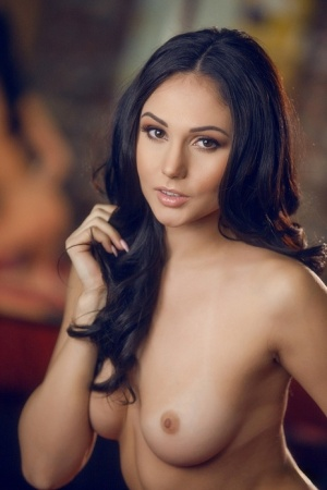 Beautiful solo model Ariana Marie pleases herself with a fake cock