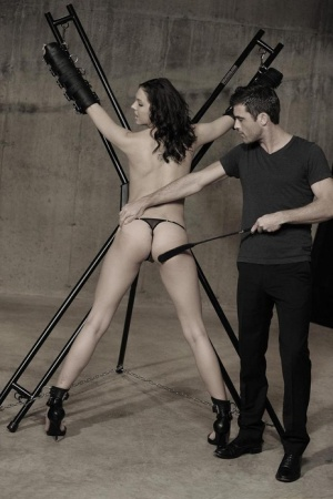 Brunette in thong and boots has her ass worked over bound to St Andrews Cross