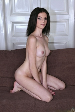 Dark haired solo girl Denisa Doll bares her big boobs as she gets naked 53655481