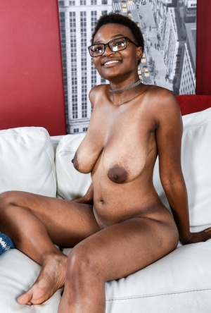 Nerdy black chick Nadyia Foxxx bares her huge boobs and pink vagina 24942508