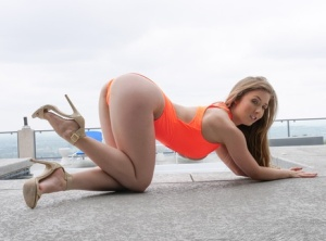 Solo model Lena Paul sticks a sex toy in her asshole on patio