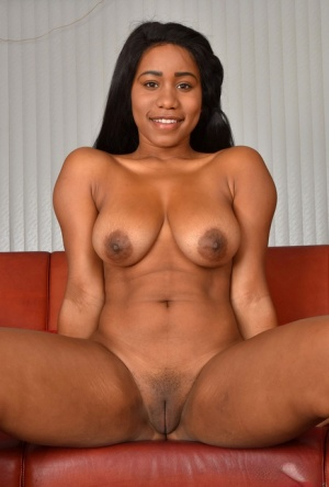 Ebony female Jenna J Foxx uncovers her big boobs before showing her pink twat