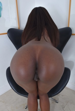Black female Ana Foxxx removes swimsuit before stretching her pussy wide open