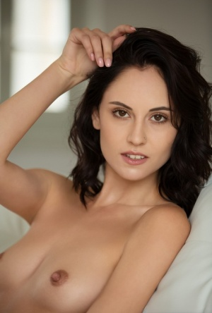 Dark haired model Sade Mare poses in the nude on her birthday for Playboy