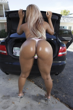 Black babe in white shorts demonstrating her amazing goodies