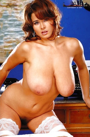 Beautiful MILF Chloe Vevrier shows her fabulous breasts in the office
