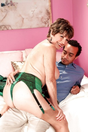 Very seductive and sexy granny Bea Cummins got dresses up in expensive green lingerie