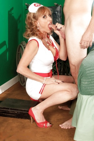 Mature nurse in sexy uniform and heels Shana DuPlae getting her cunt licked